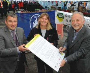 North Ayrshire Council Leader Willie Gibson, right, signs the Real Deal Charter at Saltcoats market with Lesley Maby of Spook Erection and Scott McKenzie of Trading Standards.