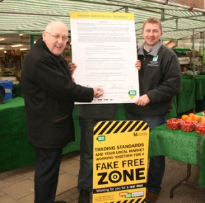 Celebrating the launch of the scheme at Hinckley are (left) Mr. Byron Rhodes, County Councillor and Designated Lead Member of Regulatory Services and (right) Gary Shepherd, Hinckley Street Market Manager.
