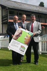 Celebrating the commitment to the Real Deal market charter are Cllr Geraint Hopkins (left), Barrie Jones (right) and James Munro, Powys County Council's Trading Standards Officer.