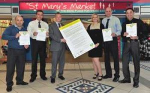 The launch of the Real Deal in St Helens with (left to right) Kevin Gavin, Markets Manager; Darrell Wilson, Chief Trading Standards Officer; Steve Littler, Estates Manager; Councillor Alison Bacon, Cabinet Member for Environmental Protection; Stephen Anders, Senior Trading Standards Officer and David McFarlane, Markets Assistant.