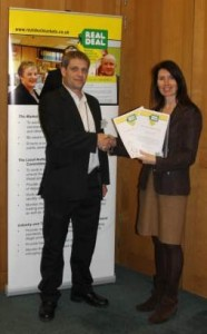 Pictured: At the Real Deal reception at Portcullis House, Westminster, Warwickshire Country Council Trading Standards Officer, Ben Downing, was presented with certificates by campaign coordinator, Patricia Lennon, for the county's latest Real Deal markets, Rugby Open Market and Rugby Farmers Market