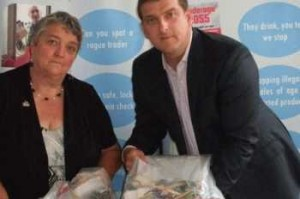 BE ON YOUR GUARD: Councillor Hazel Chase and Neil Clark, from Trading Standards, with fake goods taken from local car boot sales and markets.