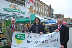 real-deal-eastleigh-market-from-l-r-cllr-roy-perry-hampshire-county-council_-market-representative-curtis-pointer_-cllr-derek-pretty-eastleigh-borough-council-2